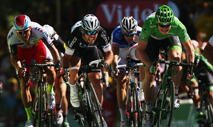 Mark Cavendish (C) of Great Britain and Etixx-Quick Step and Andre Greipel (R) of Germany and Lotto-Soudal sprint for the finish line during stage seven of the 2015 Tour de France, a 190.5km stage between Livarot and Fougeres on July 10, 2015 in Fougeres, France. (Bryn Lennon/Getty Images)