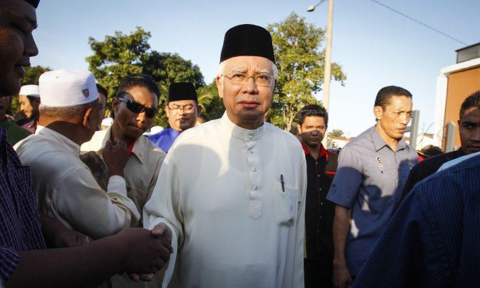Malaysian Prime Minister Najib Razak arrives for a Ramadan breakfast at a mosque in Semenyih outside Kuala Lumpur, Malaysia on Sunday, July 5, 2015. (AP Photo/Joshua Paul)
