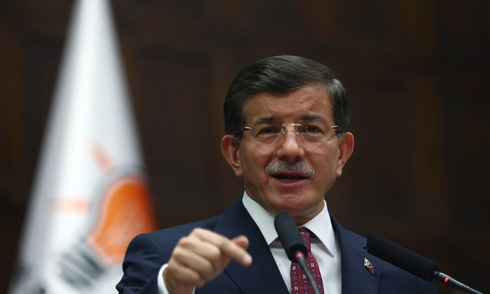 Turkish Prime Minister Ahmet Davutoglu addresses his ruling party lawmakers in Ankara, Turkey, Thursday, July 9, 2015. (AP Photo)