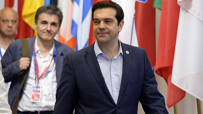 Greek Prime Minister Alexis Tsipras (R) and Finance Minister Euclide Tsakalotos leave at the end of an Eurozone Summit over the Greek debt crisis in Brussels on July 13, 2015. (Thierry Charlier/AFP/Getty Images)