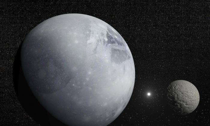 An illustration of Pluto, Charon, and Polaris. (Elena Duvernay/iStock)