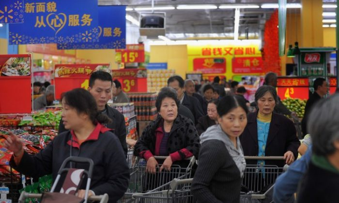 People purchase goods at a Walmart supermarket on October 25, 2011 in Chongqing, China. (ChinaFotoPress/Getty Images)