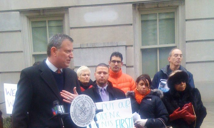 Public Advocate Bill de Blasio joined parents in front of the Tweed Courthouse on Sunday. (Courtesy of Wiley Norvell)
