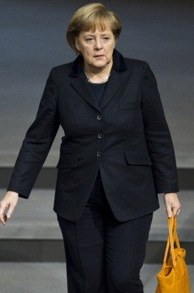 German Chancellor Angela Merkel arrives for a session of Germany's Bundestag lower house of parliament, in Berlin November 23. (JOHN MACDOUGALL/AFP/Getty Images)