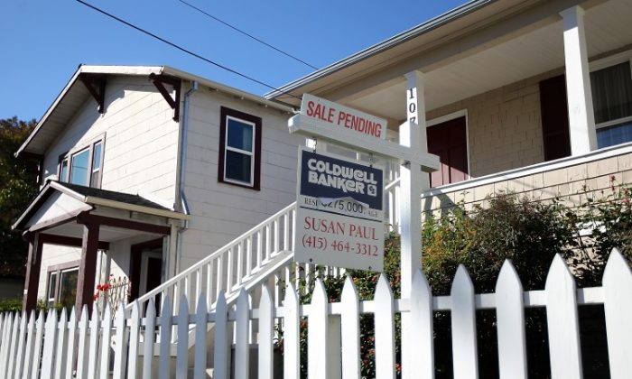 A 'sale pending' sign is posted in front of a home for sale in San Rafael, Calif., Nov. 2011. On Thursday, mortgage finance giant Freddie Mac said that the average 30-year mortgage rate rose to 3.92 percent. (Justin Sullivan/Getty Images)