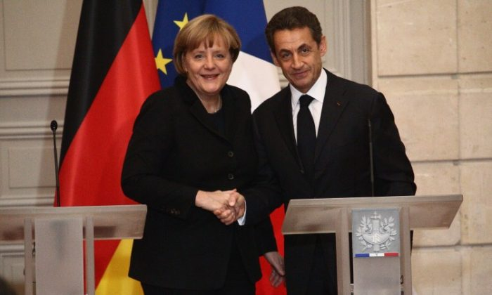 French President Nicolas Sarkozy and German Chancellor Angela Merkel attend a joint press conference for the launch of eurozone crisis talks at Elysee Palace on Dec. 5 in Paris, France. Julien M. Hekimian/Getty Images