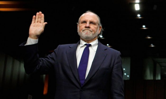 Former MF Global CEO Jon S. Corzine is being sworn in to testify at a congressional hearing on Dec. 13, 2011, regarding his firm's demise. (Chip Somodevilla/Getty Images)