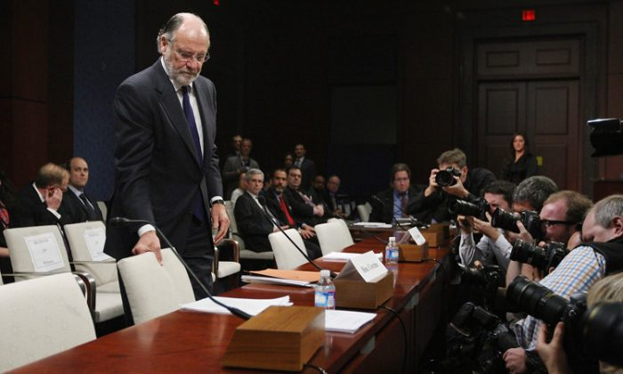 Former chairman and CEO of MF Global and former New Jersey Gov. Jon Corzine takes his seat as he arrives at a hearing before the Oversight and Investigations Subcommittee Dec. 15, 2011, on Capitol Hill. MF Global had made a transfer of cash to JPMorgan, the company's broker, of around $175 million to cover an overdrawn account on Oct. 28. Last week, it was discovered that this transfer was requested by former CEO Jon S. Corzine. (Alex Wong/Getty Images)