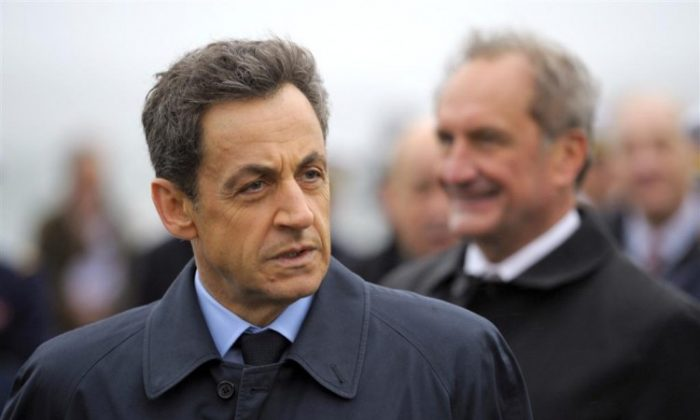 French President Nicolas Sarkozy is seen at the Lanveoc-Poulmic naval airbase in Lanveoc, France, on January 3. In a speech at the airbase Sarkozy called on Syrian President Bashar al-Assad to step down. (Philippe Wojazer/AFP/Getty Images)