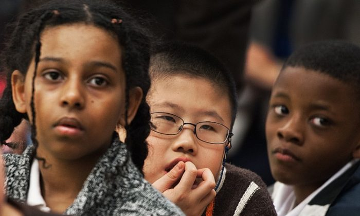 Students listen to Fukaya Elementary School Principal Chikako Maruyama as he shares experiences with low-income children on Jan. 5 at Thomson Elementary School in Washington, DC. (PAUL J. RICHARDS/AFP/Getty Images)