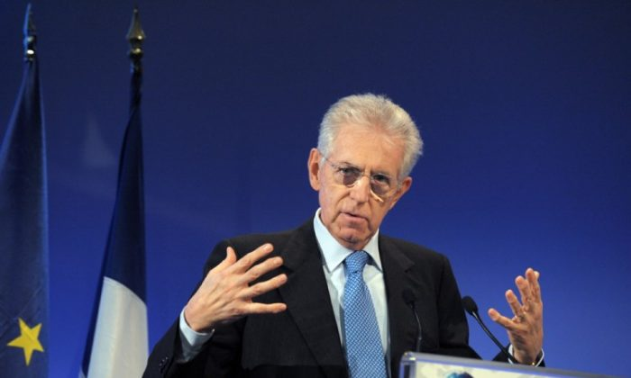 Italian Prime Minister Mario Monti gives a speech to close the 4th edition of the New World Conference at the Economy Ministry in Paris on Jan. 6. (ERIC PIERMONT/AFP/Getty Images)