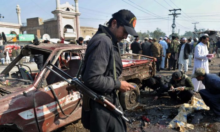 Pakistani security personnel examines the site of a bomb blast in Jamrud on January 10, 2011. A remote-controlled bomb blast killed 35 people and wounded more than 60 others in the deadliest attack in months in the Taliban-hit tribal region of northwest Pakistan. (A. Majeed/AFP/Getty Images}