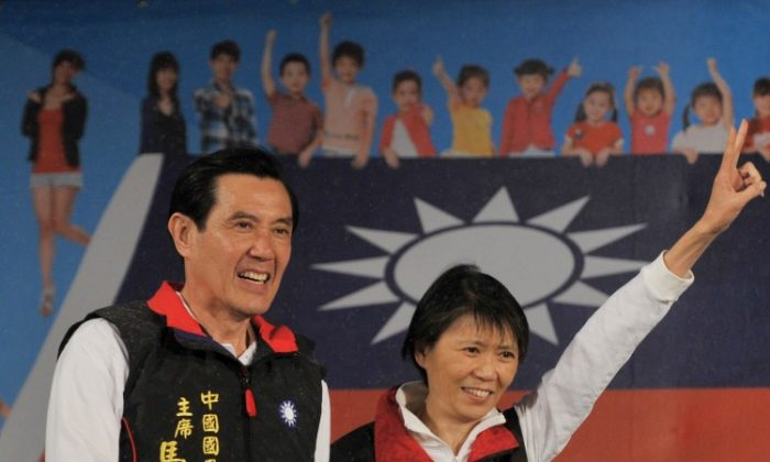Taiwan President of the ruling Kuomintang Party Ma Ying-jeou and his wife Chou Mei-ching smile as they step on stage after voting results showed that he won the election at his campaign headquarters in Taipei on Jan. 14, 2012. (Aaron Tam/AFP/Getty Images)