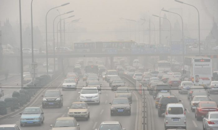 Vehicles drive through smog on a Beijing road on Jan. 18. Pollution from Chinese electric cars could be more harmful to health than that of gasoline vehicles according to researchers at the University of Tennessee. (STR/AFP/Getty Images)