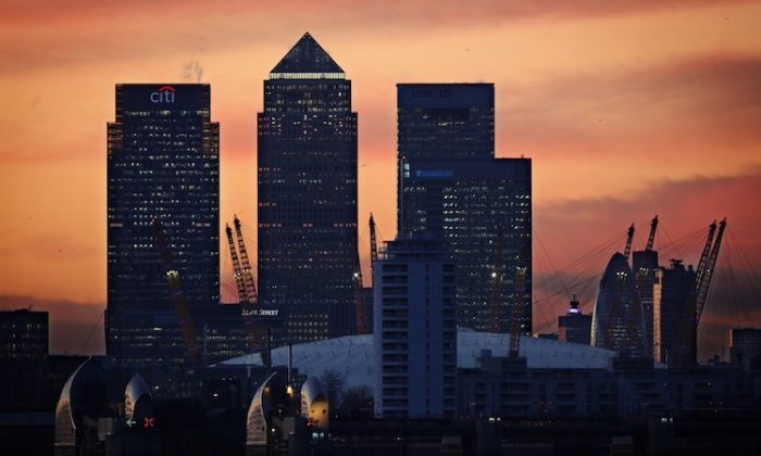 The sun sets behind the London skyline and the nation's financial centre. The British Chambers of Commerce believe that the country will not go back into recession, although recovery will be weak . (Dan Kitwood/Getty Images)