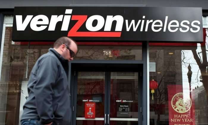 A pedestrian walks by a Verizon Wireless store on January 24, 2012 in San Francisco, California. (Justin Sullivan/Getty Images)
