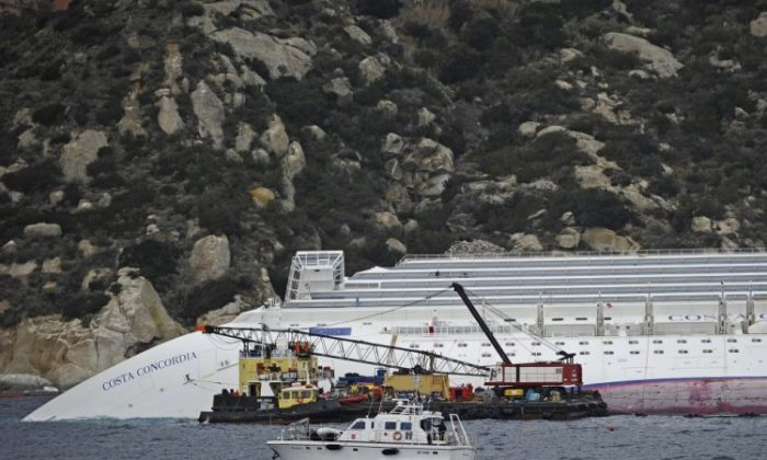 Technicians work near the stricken Costa Concordia cruise ship near Giglio island on January 27, 2012. (Filippo Monteforte/AFP/Getty Images}