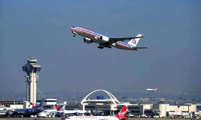 American Airlines passenger plane takes off from Los Angeles International airport on Feb. 1 in Los Angeles, Calif. The Department of Transportation has passed new rules requiring airlines to post the full cost of airline tickets. (Kevork Djansezian/Getty Images)