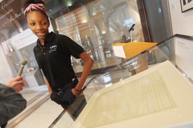 African-American student Naya Rogers, 13, is interviewed next to a rare handwritten copy of the Thirteenth Amendment which abolished slavery after it was unveiled at the New York Historical Society on February 1, 2012 in New York City. The document, signed by Abraham Lincoln, was unveiled to coincide with Black History Month and will be on display until April 1. (Mario Tama/Getty Images)