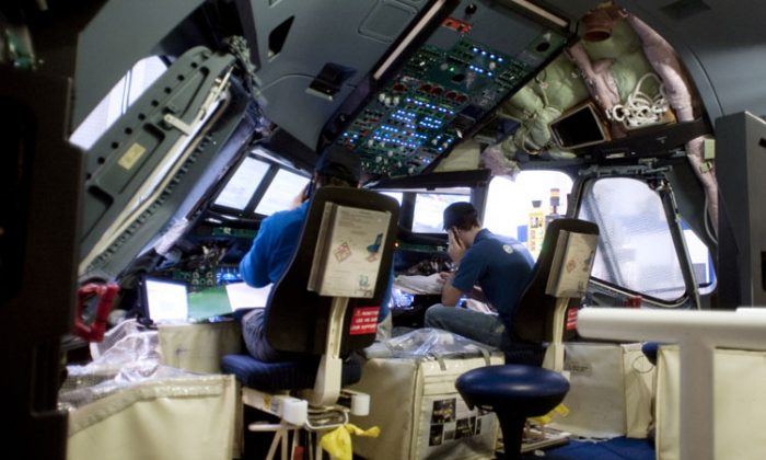 Employees are at work in the cockpit of an A380 plane at the assembly line at Airbus plant, the European aircraft manufacturer, on February 2, 2012 in Blagnac, southwestern France. (Pascal Pavani/AFP/Getty Images)