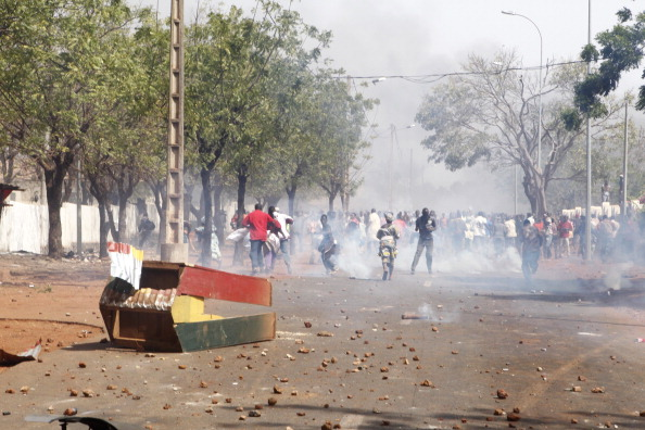 """Relatives and supporters of soldiers fighting rebels Tuareg in the north, clash with security forces during a protest against the """"weak"""" response to attacks by the rebels, in Bamako on February 2, 2012. (STRINGER/AFP/Getty Images)"""