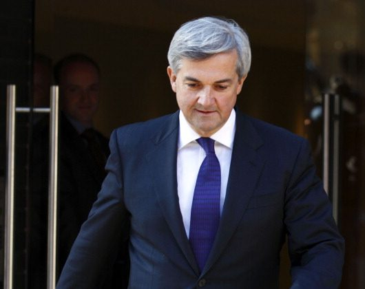 British Energy and Climate Change Secretary Chris Huhne walks out of the door of his London flat on February 3, 2012 to give a statement to the media resigning as energy and climate secretary over speeding charges. In a brief statement to the press Huhne resigned his position in the Cabinet and reaffirmed his innocence after the Crown Prosecution Service (CPS) announced that they would be bringing charges against Huhne over allegations he dodged a speeding penalty. (Justin Tallis/AFP/Getty Images)