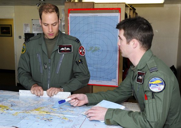 In this handout image provided by the Ministry of Defence, Prince William, Duke of Cambridge (L) and his crew prepare for their first sortie of a six week deployment on February 4, 2012 in the Mount Pleasant Complex, Falkland Islands. Operating the Sea King Mk3 as part of 1564 Flight, their duties as part of the Royal Air Force Search and Rescue team include assistance to the vast array of shipping around the islands and mountain rescue, in addition to providing cover for the aviation assets based on the island. Flt Lt Wales is a fully qualified SAR helicopter pilot and this is his first overseas operational deployment. (Sgt Andy Malthouse/MoD via Getty Images)