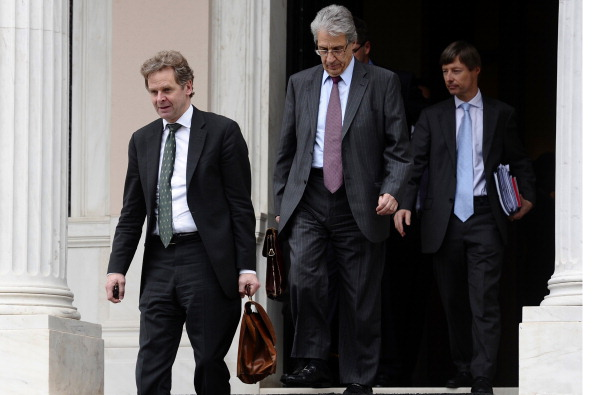 Poul Thomsen (L), a senior International Monetary Fund official, leaves the office of Greek Prime Minister Lucas Papademos after their meeting in Athens on February 5, 2012. (Aris Messinis/AFP/Getty Images)