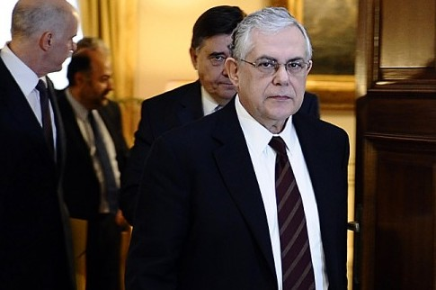 Greek Prime Minister Lucas Papademos (R) looks on before his meeting with Greek political party leaders in Athens on Feb. 5. Papademos secured an agreement to further cut the nation's budget. (ARIS MESSINIS/AFP/Getty Images)