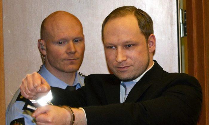 Anders Behring Breivik, (R) arrives in court in Oslo on Feb. 6. (Daniel Sannum Lauten/AFP/Getty Images)