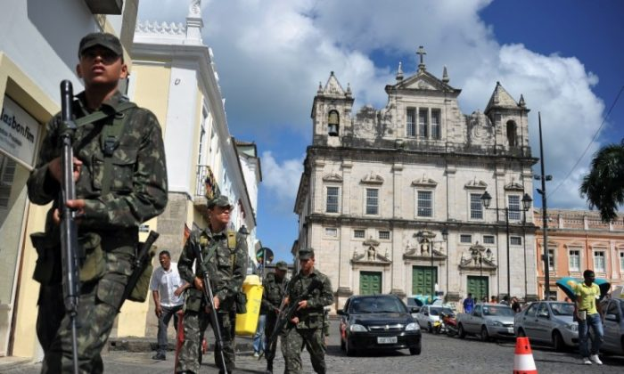 Brazilian soldiers patrol the city of Salvador as part of security operations following a strike by the state military police, on February 7, 2012. (Christophe Simon/AFP/Getty Images)