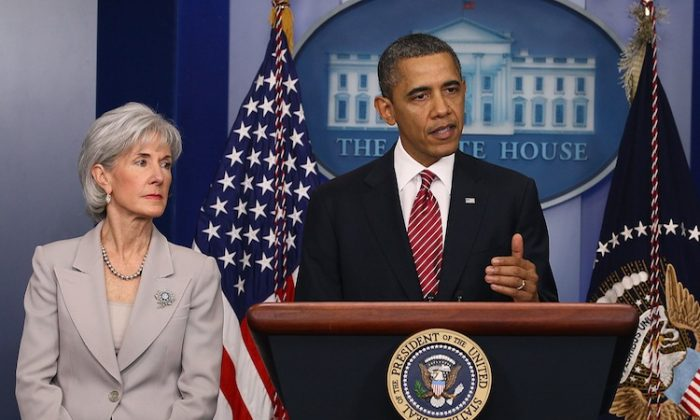 President Barack Obama is joined by Health and Human Services Secretary Kathleen Sebelius while making a statement in the briefing room at the White House on Feb. 10. Obama announced a reversal of his administration's health care rule requiring religious employers to provide women free access to contraception. (Mark Wilson/Getty Images)