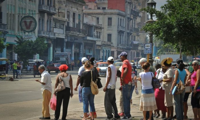 Cubans line up at a bus stop in Havana, on Feb. 10. (Adalberto Roque/AFP/Getty Images)