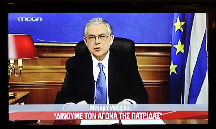 A picture of a TV screen shows Greek Prime Minister Lucas Papademos during his televised address to the nation late on Feb. 11, before parliament voted to approve a new set of austerity measures. (Louisa Gouliamaki/AFP/Getty Images)