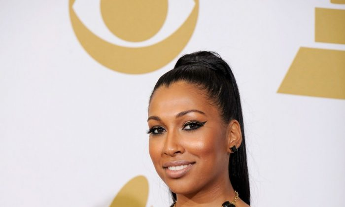 """Singer Melanie Fiona holds her awards for Best R&B Song and Best Traditional R&B Performance (""""Fool For You"""") at the 54th annual Grammy Awards in Los Angeles on Feb. 12. Montreal's Caroline Robert won Best Recording Package for Arcade Fire's """"Scenes from the Suburbs."""" """"Canada is blessed with a vibrant music scene that continues to generate award-winning artists and composers appreciated around the globe,"""" said Prime Minister Stephen Harper in a congratulatory statement. Heritage Minister James Moore also congratulated the pair, saying the Grammys """"have once again put Canadian music firmly in the world spotlight. The artists who have represented us at this important event are true international ambassadors of Canadian culture."""" Other winners include Adele, Foo Fighters, Kanye West and Jay-Z, and Bon Iver. The event also included a tribute to Whitney Houston, who died Feb. 11 at the age of 48.(Kevork Djansezian/Getty Images)"""