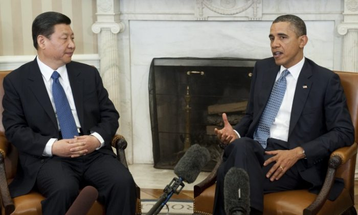 US President Barack Obama and Chinese Vice President Xi Jinping speak during meetings in the Oval Office of the White House in Washington, DC, Feb. 14, 2012. (Saul Loeb/AFP/Getty Images)