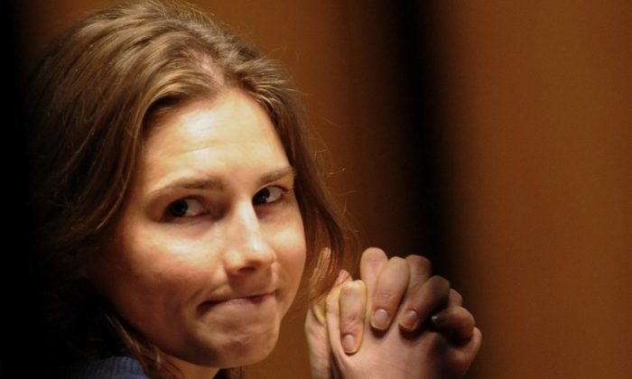 File photo of American Amanda Knox at her appeal trial in Perugia's courthouse on March 12, 2011. Knox, who was cleared of murdering her housemate in Italy, just signed a $4 million book deal with Harper Collins. (Tiziana Fabi/AFP/Getty Images)