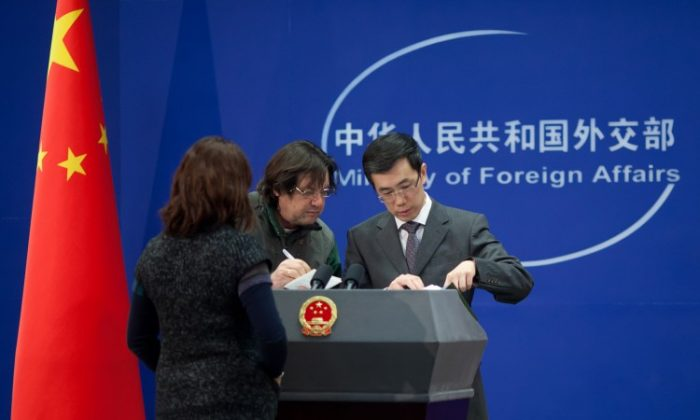 China's Foreign Ministry spokesperson Liu Weimin (R) . (Ed Jones/AFP/Getty Images)