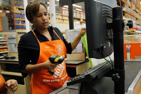 A new hire at Home Depot rings up a sale for a customer while being trained on the cash register in Miami, Fla., on Feb. 16. Federal government data indicated that the nation added 243,000 jobs last month, pushing the unemployment rate to 8.3 percent, and bolstering both consumer and investor confidence. (Joe Raedle/Getty Images)