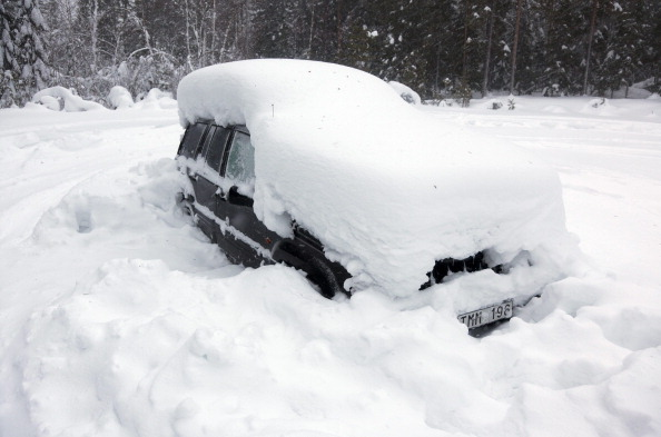 A snowed covered car sits roadside in the woods north of Umea in Northern Sweden on February 18, 2012. (Rolf Hojer/AFP/Getty Images)