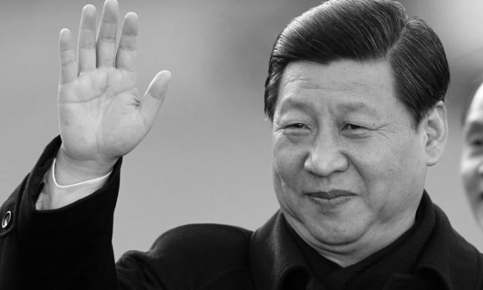 Xi Jinping waves to the media upon his arrival at Shannon airport, in Ireland, on Feb. 18, 2012. (Peter Muhly/AFP/Getty Images)