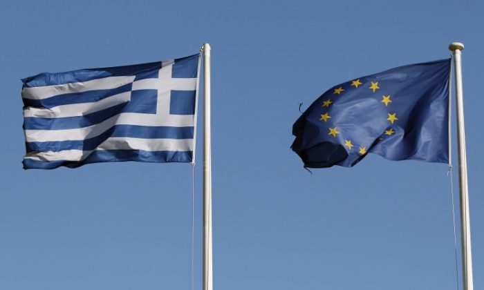 A Greek and an EU flag fly outside the Acropolis Museum on February 19, in Athens, Greece. (Oli Scarff/Getty Images)