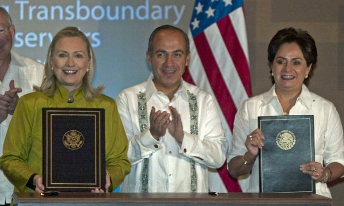 (L to R) US Secretary of State Hillary Rodham Clinton, Mexico's President Felipe Calderon and Mexico's Foreign Minister Patricia Espinosa (R), pose after signing the United States-Mexico Agreement Concerning Transboundary Hydrocarbon Reservoirs in the Gulf of Mexico, on the sidelines of the G20 foreign ministers summit in Los Cabos, Mexico, on February 20, 2012. (Fernando Castillo/AFP/Getty Images)
