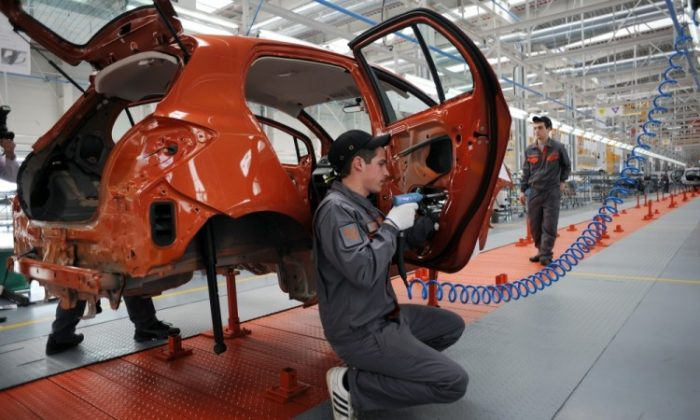 Employees work on the assembly line of the new Great Wall Motors car plant in the village of Bahovitsa on Feb. 21. China's Great Wall Motors eyes to enter the European market with cars assembled in Bulgaria. (Nikolay Doychinov/AFP/Getty Images)