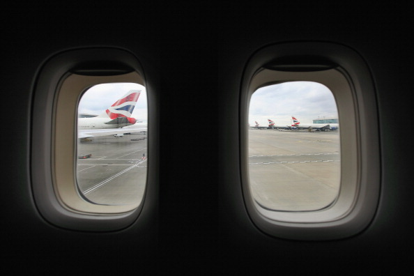 The tail-fin of a British Airways Boeing 747 aircraft is seen through the window of an adjacent plane at Heathrow airport's Terminal 5 on February 21, 2012 in London, England. Heathrow is the UK's largest airport with 89 airlines serving 176 different destinations in 90 countries around the world; in 2010 it handled 65.7 million passengers on over 449,000 flights. (Photo by Oli Scarff/Getty Images)