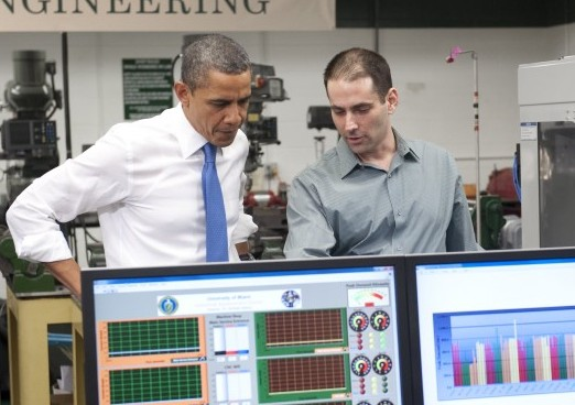President Barack Obama talks with student Hanzala Siddiq (R), as he tours the Industrial Assessment Center at the University of Miami prior to speaking on the economy in Miami, Fla., on Feb. 23. The center teaches students about industrial energy efficiency. (SAUL LOEB/AFP/Getty Images)