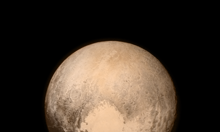 The last and most detailed image of Pluto sent to Earth by the New Horizons spacecraft before the moment of closest approach, which was at 7:49 a.m. EDT, Tues., July 14, 2015. (NASA)