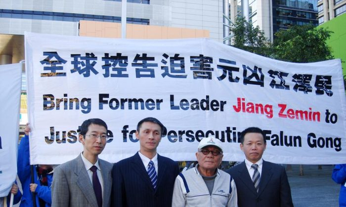 Xie Weiguo stands second from left in Brisbane on July 14, 2015. With him are, left from right, John Meng, Qiu Cuiliang, and Yu Ping, all of whom filed criminal complaints against former Chinese leader Jiang Zemin recently. (Minghui.org)