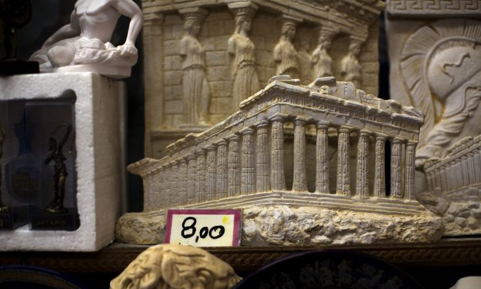 Souvenirs of the ancient parthenon temple on sale at a shop in central Athens, Tuesday, July 14, 2015.  Greek Prime Minister Alexis Tsipras was seeking Tuesday to rally his party members to support a preliminary rescue deal struck with Greeceís European creditors that includes measures so onerous some of his own ministers were in open revolt. (AP Photo/Emilio Morenatti)