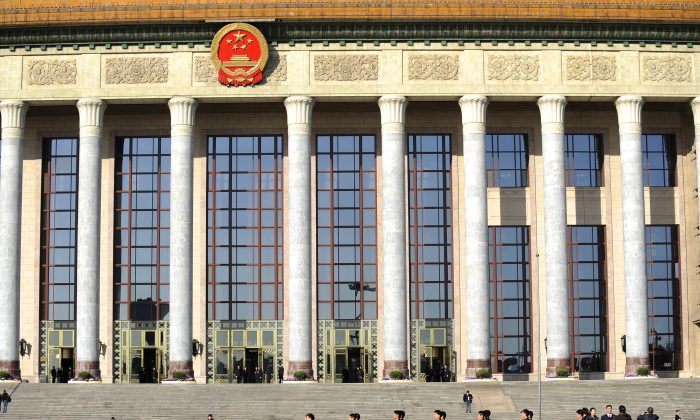 A squad of security personnel march during the National People's Congress in front of the Great Hall of the People in Beijing on Mar. 9, 2011. (Liu Jin/AFP/Getty Images)